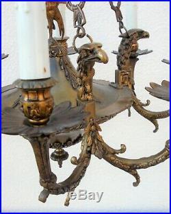 Beau lustre Empire bronze têtes d'aigles
