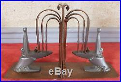 Edgar Brandt paire serre livres bronze et métal pélican bookends
