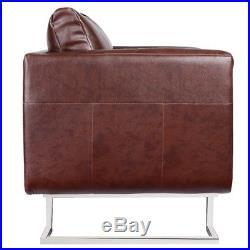 Fauteuil brun avec pieds chromées cabriolet coussin patchwork décoration