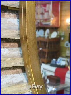 Glace / miroir biseauté à cerclage métallique doré cuivré Diam 86 cm