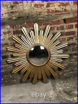 Glace / miroir soleil André en tôle doré oeil de sorcière Diam 90 cm