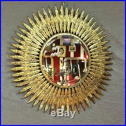 Glace / miroir soleil tôle doré et miroir biseauté style Années 1970 diam 62,5
