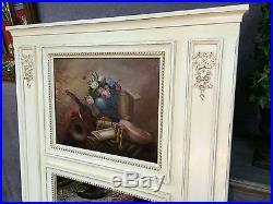 Glace / trumeau en bois sculpté et peinture craquelée