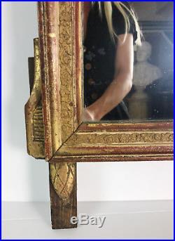 MIROIR / GLACE ANCIENNE D'ÉPOQUE LOUIS XVI (18e siècle) EN BOIS SCULPTÉ ET DORÉ