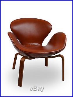 Ultra rare fauteuil swan d'Arne Jacobsen Fritz Hansen pieds bois cuir cognac